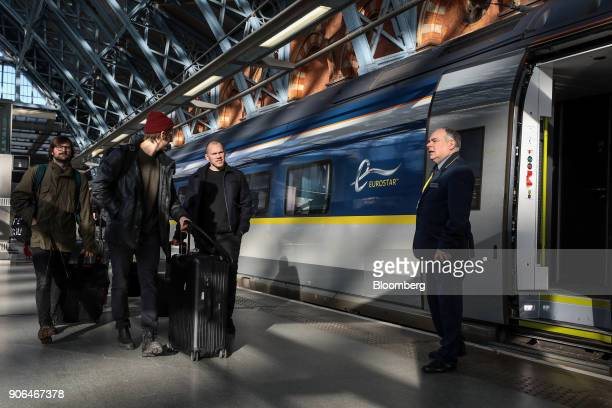 Passengers walk on the platform after arriving on a train operated by Eurostar International Ltd at St Pancras International railway station in...