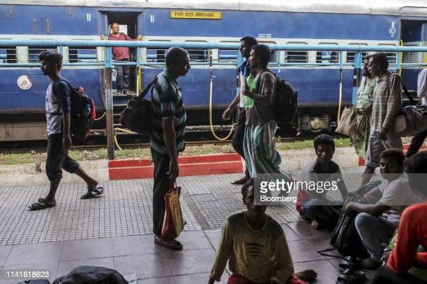 Passengers walk past a train at Bhubaneshwar Railway Station after Cyclone Fani passes in Bhubaneshwar Odisha India on Sunday May 5 2019 Authorities...