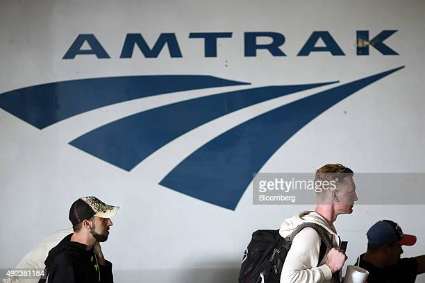 Passengers walk past an Amtrak locomotive inside Union Station in Chicago Illinois US on Thursday Oct 8 2015 The head of Amtrak warned Congress that...