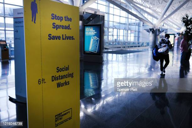 Passengers walk through a near empty John F. Kennedy Airport due to the ongoing cutbacks in travel because of the coronavirus on April 16, 2020 in...