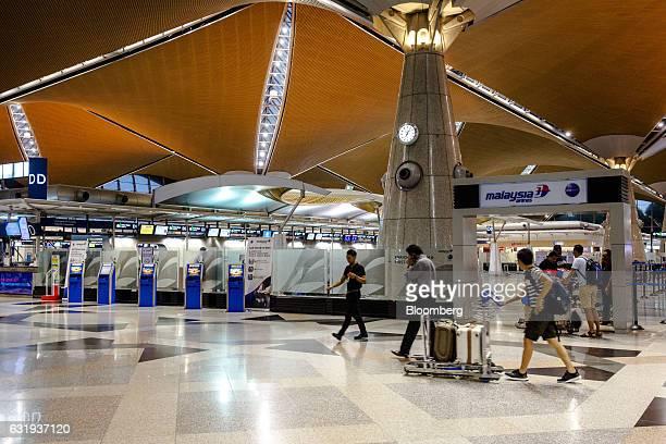 Passengers walk through the checkin hall at Kuala Lumpur International Airport in Sepang Selangor Malaysia on Tuesday Jan 17 2017 The hunt for...