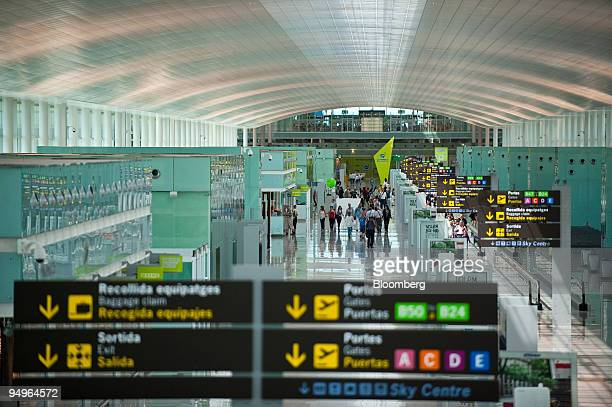 Passengers walk through the new Terminal 1 building at El Prat International Airport in Barcelona Spain on Tuesday June 30 2009 Barcelona airport is...
