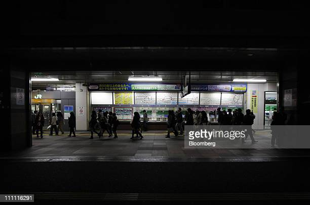 Passengers walk ticketing machines at Shinjuku Station in Tokyo Japan on Monday March 28 2011 As Tokyo Electric Power Co the utility battling to...
