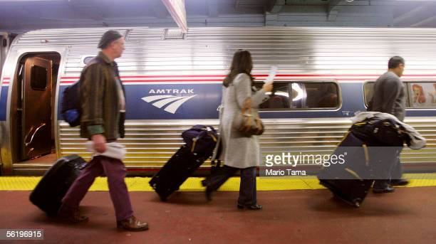 Passengers walk to board an Amtrak train in Penn Station November 17 2005 in New York City Transportation Secretary Norman Y Mineta said today that...
