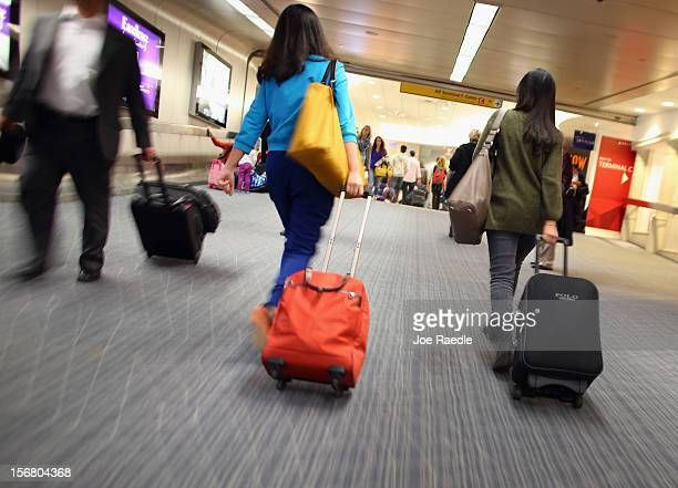 Passengers walk to their depature gates in LaGuardia Airport as they travel on the day before Thanksgiving on November 21 2012 in New York United...
