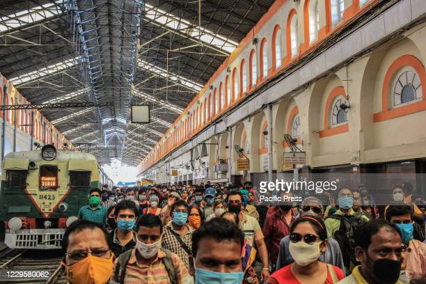 Passengers walking at the train station wearing face mask as mandatory protocols. After more than seven months of closure, local train services...