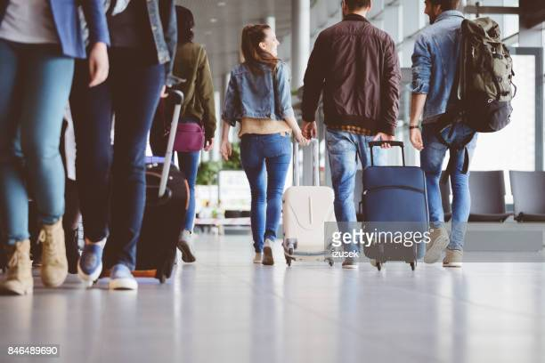 passengers walking in the airport corridor - passenger stock pictures, royalty-free photos & images