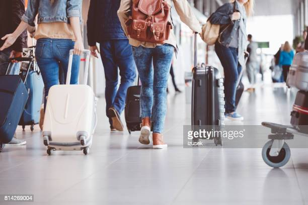 passengers walking in the airport terminal - arrival photos stock photos and pictures