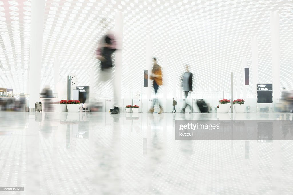 passengers walking in the hall interior : Stock Photo