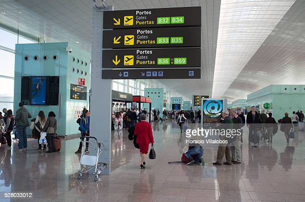 Passengers wander in the boarding area of Terminal 1of Barcelona El Prat Airport in El Prat de Llobregat near Barcelona Catalonia Spain 31 March 2013...