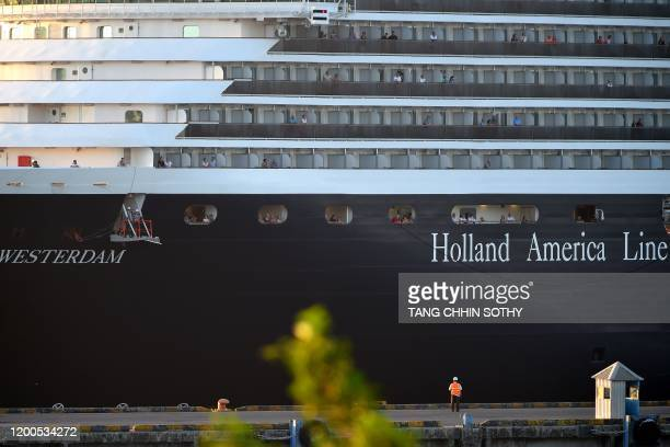 Passengers watch as the Westerdam cruise ship arrives at the port in Sihanoukville on Cambodia's southern coast on February 13 where the liner had...