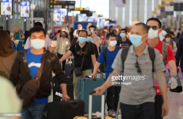 Passengers wear face masks as a protective measure against the corona virus at Suvarnabhumi airport Ministry of Public Health of Thailand announced...