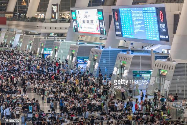 Passengers wear face masks at the waiting hall of Hangzhou East Railway Station on August 7, 2020 in Hangzhou, Zhejiang Province of China.