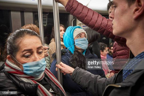 Passengers wear face masks in the Paris Metro as cases of Coronavirus rise in France on March 1 2020 in Paris France France has reported 100 cases of...