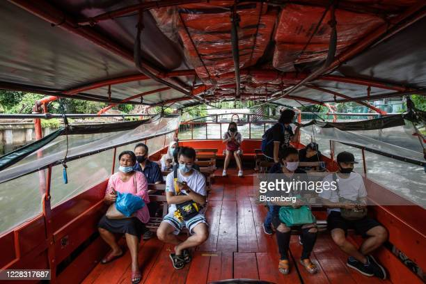 Passengers wear protective masks while travelling by water taxi in Bangkok Thailand on Wednesday Sept 2 2020 Thailand has reported zero...