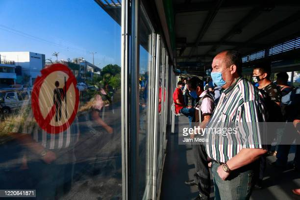 Passengers wear protective masks while waiting a metropolitan bus on April 20, 2020 in Guadalajara, Mexico. Mexico started what the authorities call...
