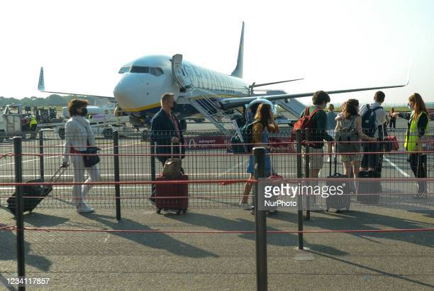 Passengers wearing face masks board the Ryanair plane at Paris-Beauvais airport. On Thursday, July 22 in BeauvaisTillé Airport, Oise,...