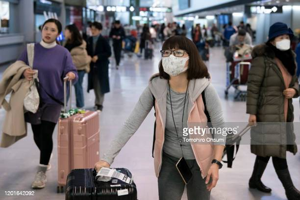 Passengers wearing masks arrive at Narita airport on January 24, 2020 in Narita, Japan. While Japan is one of the most popular foreign travel...