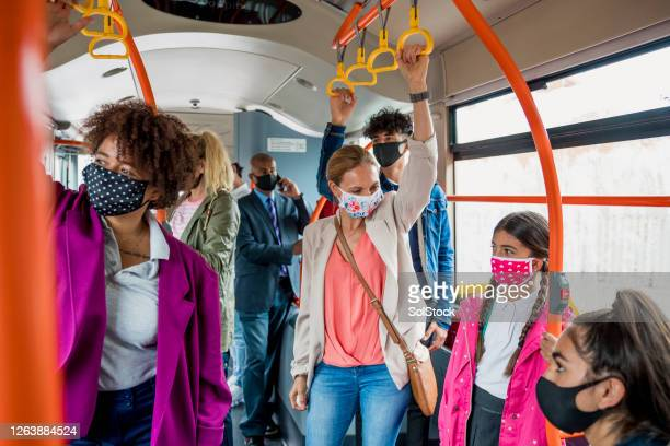 passengers wearing masks during rush hour - public transport stock pictures, royalty-free photos & images