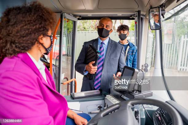 passengers wearing masks - gender identity stock pictures, royalty-free photos & images