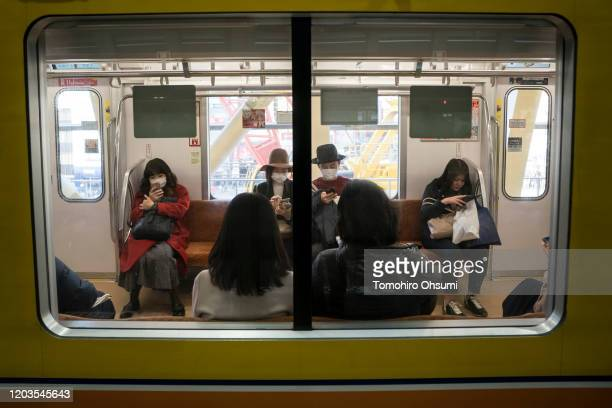 Passengers wearing masks travel on a subway train on February 02 2020 in Tokyo Japan Japan reported 20 cases of Wuhan coronavirus infections as the...