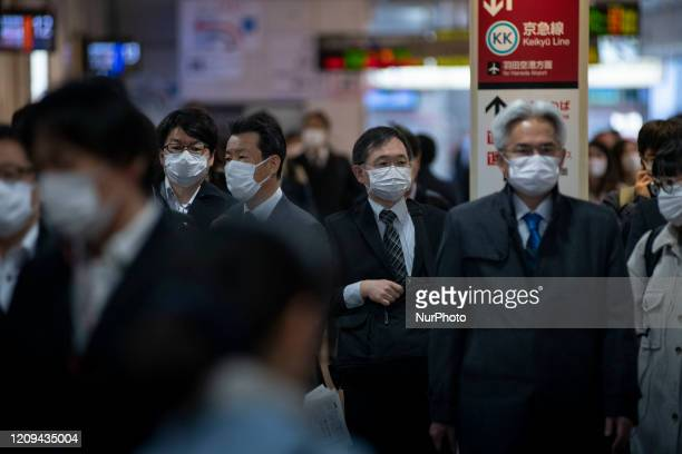 Passengers wearing protective face masks, following an outbreak of the coronavirus disease , are seen at a station after the government announced the...