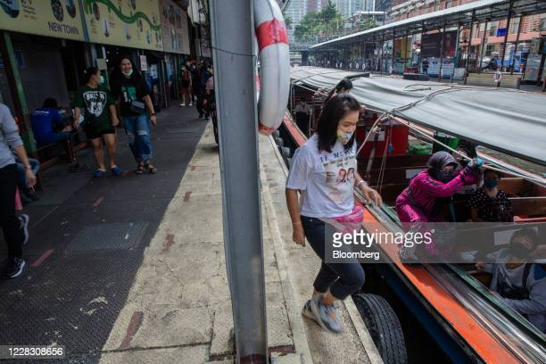 Passengers wearing protective masks board a water taxi in Bangkok Thailand on Wednesday Sept 2 2020 Thailand has reported zero locallytransmitted...