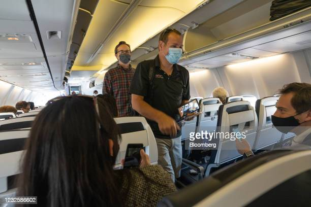 Passengers wearing protective masks masks board a Boeing Co. 737-800 operated by Avelo Airlines ahead of the airline's inaugural flight at Hollywood...