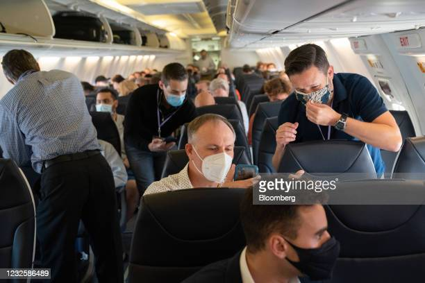 Passengers wearing protective masks onboard a Boeing Co. 737-800 operated by Avelo Airlines ahead of the airline's inaugural flight at Hollywood...