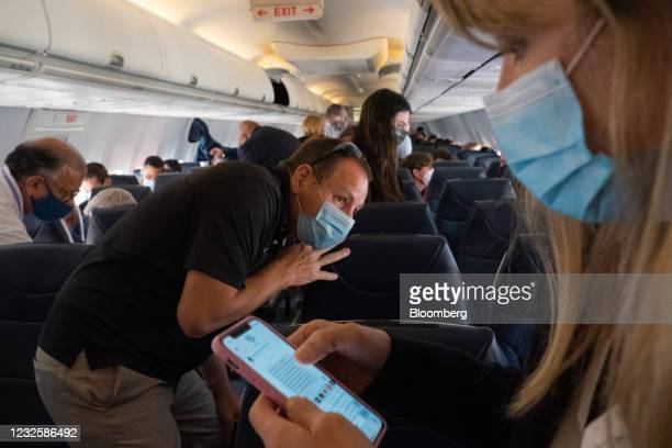 Passengers wearing protective masks prepare to disembark after the Avelo Airlines inaugural flight arriving at Charles M. Schulz Sonoma County...