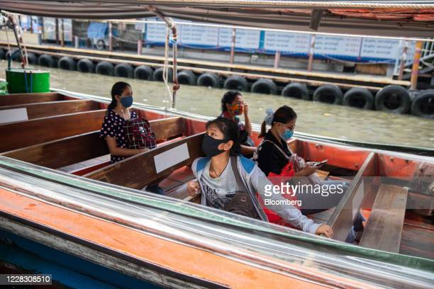 Passengers wearing protective masks sit in a water taxi in Bangkok Thailand on Wednesday Sept 2 2020 Thailand has reported zero locallytransmitted...