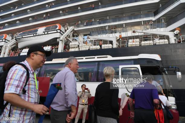 Passengers who disembarked from the Westerdam cruise ship get on a bus in Sihanoukville on February 14 where the liner docked after being refused...