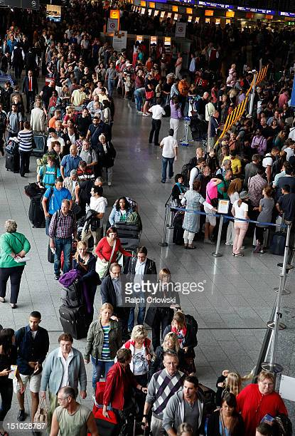 Passengers whose flights were cancelled wait in line during a strike by Lufthansa flight attendants at RheinMain Airport on August 31 2012 in...