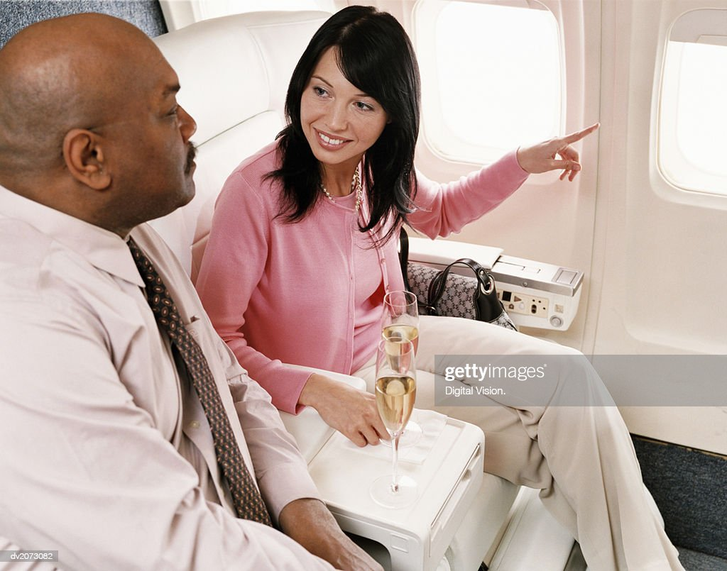 Passengers With Champagne in an Aircraft Cabin Interior : Stock Photo