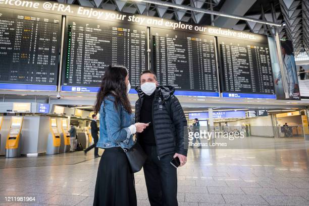 Passengers with face masks pictured at Frankfurt Airport on March 12, 2020 in Frankfurt, Germany. U.S. President Donald Trump has announced he is...