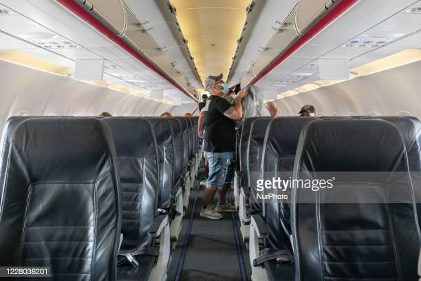 Passengers with facemasks boarding inside an Aegean Airbus A320. Flying in an Aegean Airlines Airbus A320 during the Coronavirus pandemic era with...