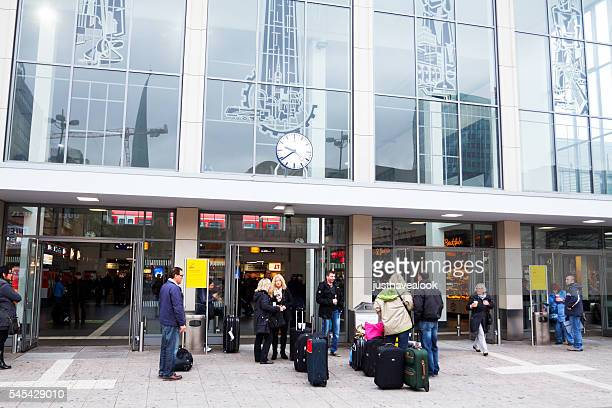 Passengers with luggage outside of station Dortmund