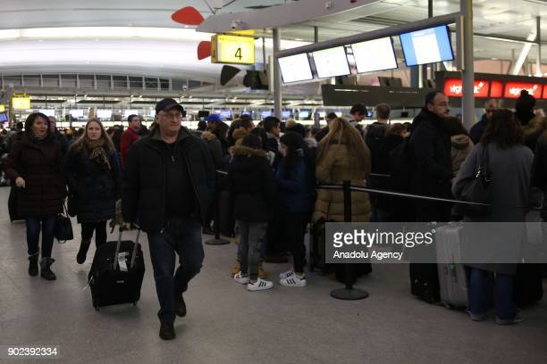 Passengers with their luggage are seen during the weatherrelated cancellation at the John F Kennedy Airport in New York United States on January 08...