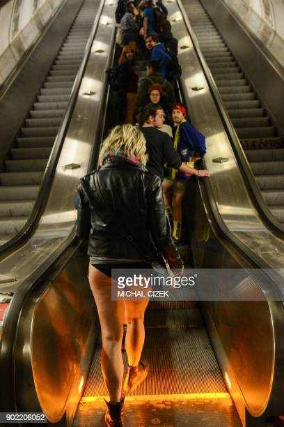 Passengers without pants ride an escalator in a subway station during the No Pants Subway Ride on January 7 2018 in Prague The No Pants Subway Ride...