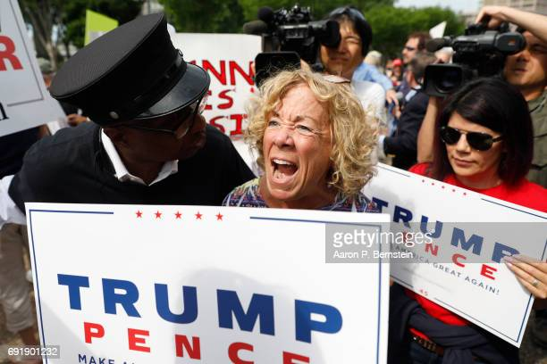 A passerby confronts demonstrators gathered outside the White House who were gathered to show support for President Donald Trump on June 3 2017 in...