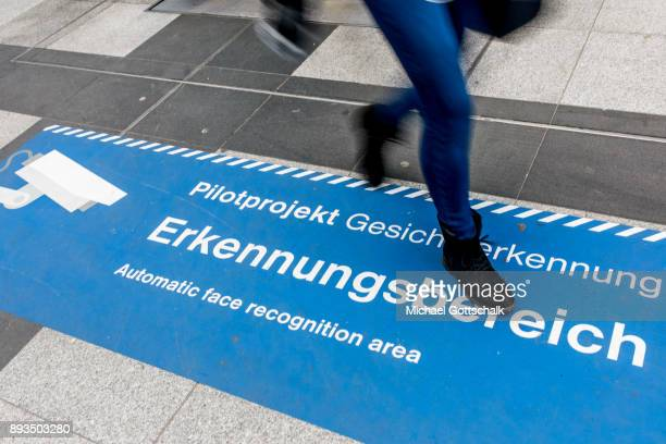 A passerby crosses signs which indicate the area for automatic recognition of faces at trainstation Suedkreuz on December 15 2017 in Berlin Germany