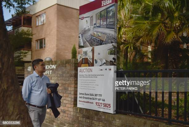 A passerby looks at an apartment advertised for auction in Sydney on May 9 2017 Australian treasurer Scott Morrison will present the annual Budget...