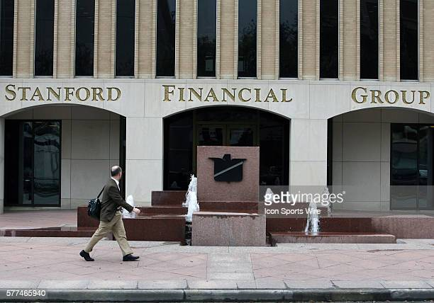 A passerby looks at one of the Stanford Financial Group offices after officials raided the company after high returns on certificates of deposit at a...