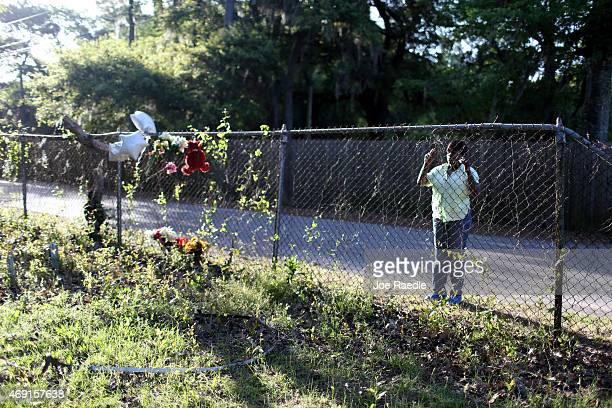A passerby looks on at the site where Walter Scott was killed on April 4th by a North Charleston police officer on April 10 2015 in North Charleston...