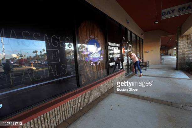 A passerby peeks in the window outside outside Orchids of Asia Day Spa in Jupiter FL where New England Patriots owner Robert Kraft is alleged to have...