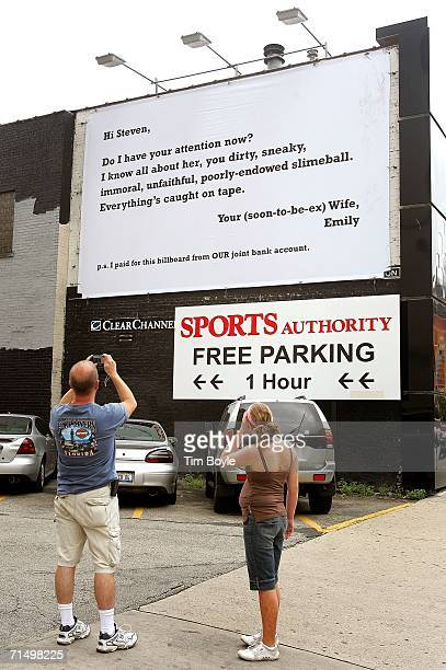 A passerby photographs a billboard claiming to be from an unhappy wife railing against her husband's infidelity July 21 2006 in Chicago Illinois Some...