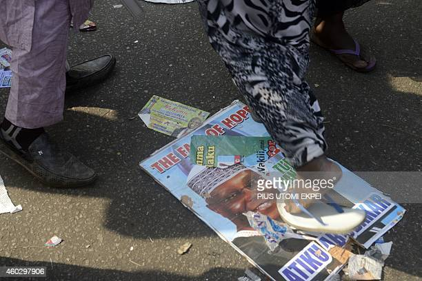 A passerby steps on poster of the opposition All Progressives Congress presidential aspirant and former VicePresident Atiku Abubakar during the...