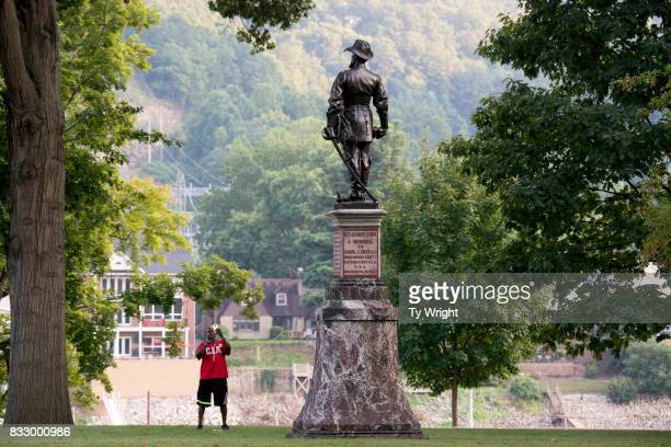 A passerby stops to take a picture of the statue of Confederate General Thomas Stonewall Jackson at the West Virginia State Capitol Complex on August...