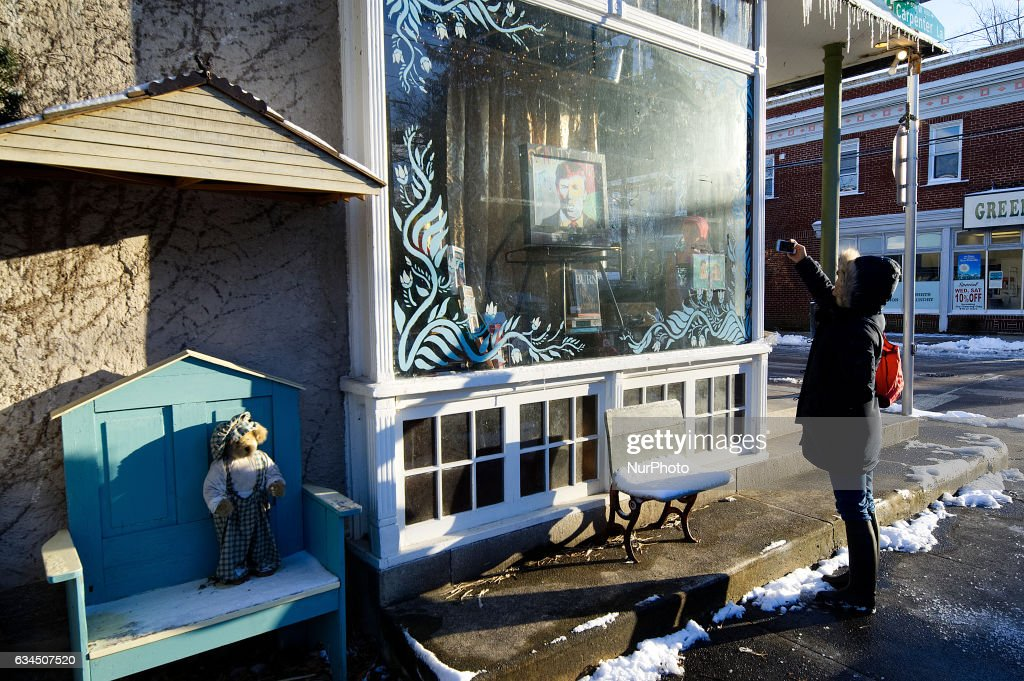 Passer-by takes a photo of the picture window with a painted portrait of President Donald Trump is on display in the window of Moving Arts of Mount Airy. Signs of vandalism appear on the picture window of a store in the West Mount Airy section of Philadelphia, PA, on February 9th, 2017. The store is located across the long time neighborhood staple CO-OP Weavers Way grocery store, which anchored the liberal and diverse Northwest Philadelphia neighborhood.