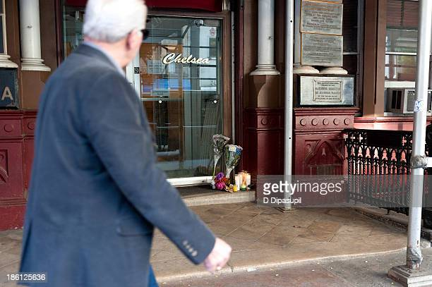 Passerby views a makeshift memorial for Lou Reed at the Hotel Chelsea on October 28, 2013 in New York City. Lou Reed died at his home in East...